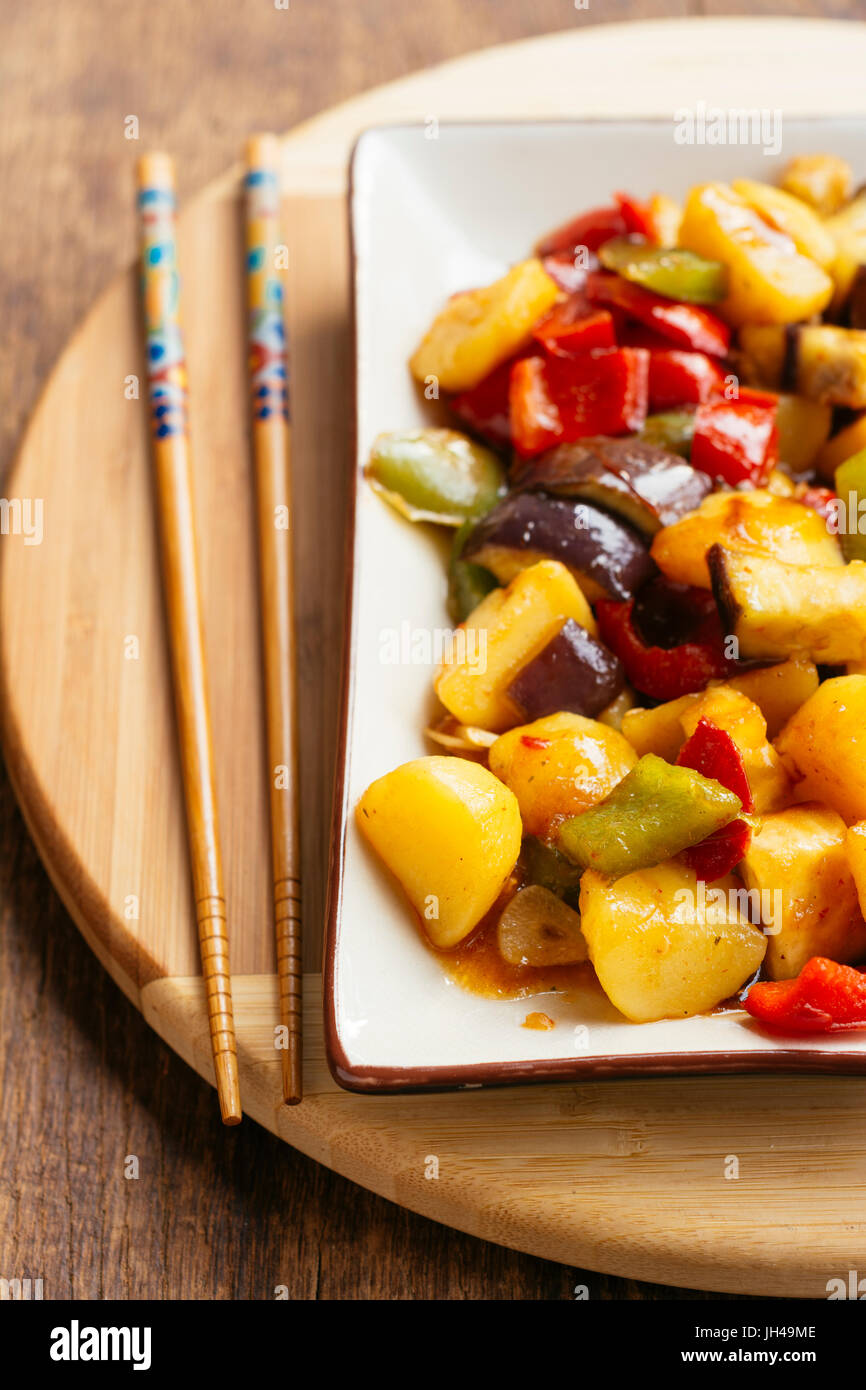 Stir-fried potatoes with eggplant and bell pepper.Stock Photo
