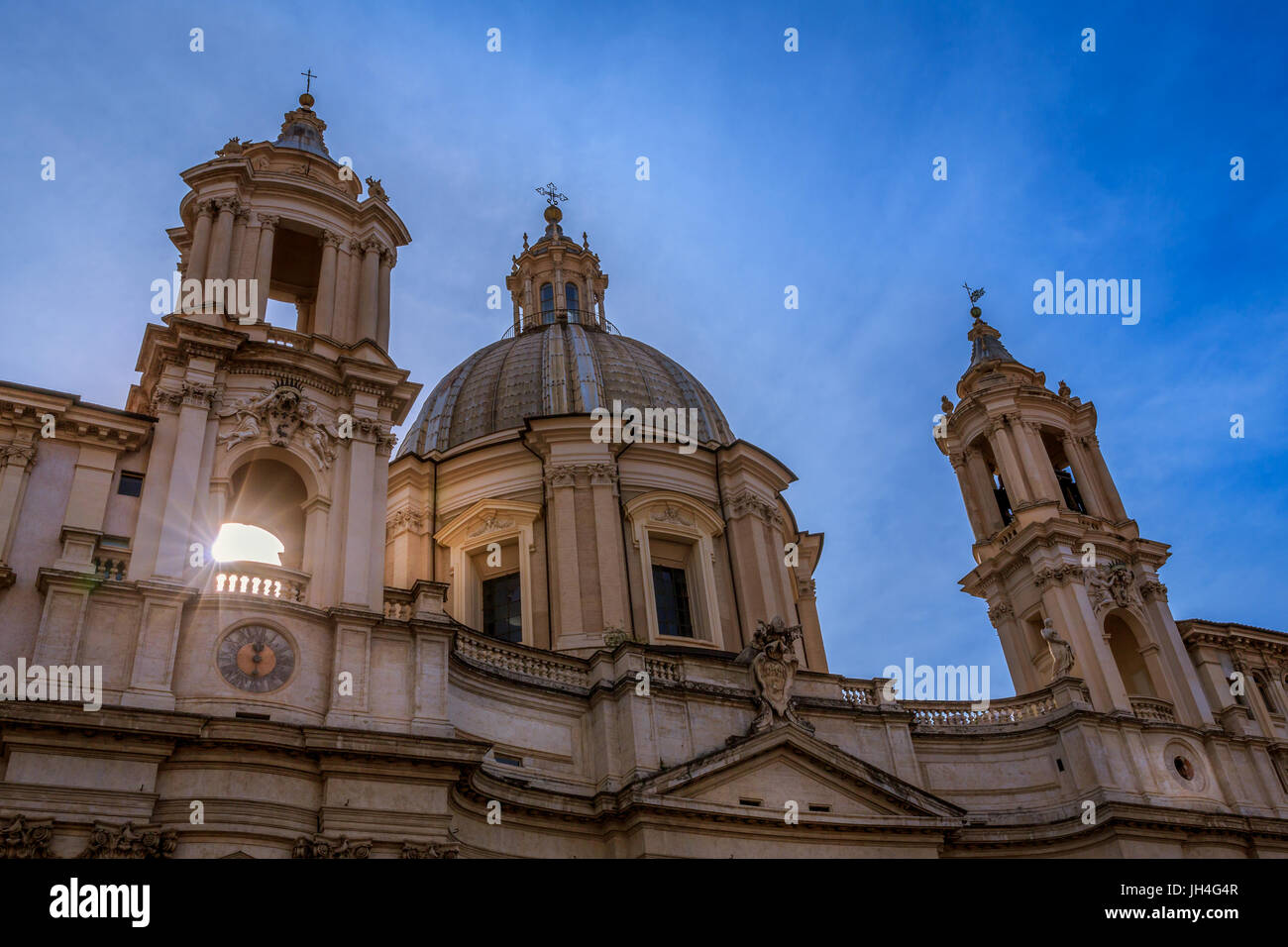 A bright sunburst through the church tower of Sant'Agnese in Agone, Piazza Navona, Rome, Lazio, Italy - Stock Image