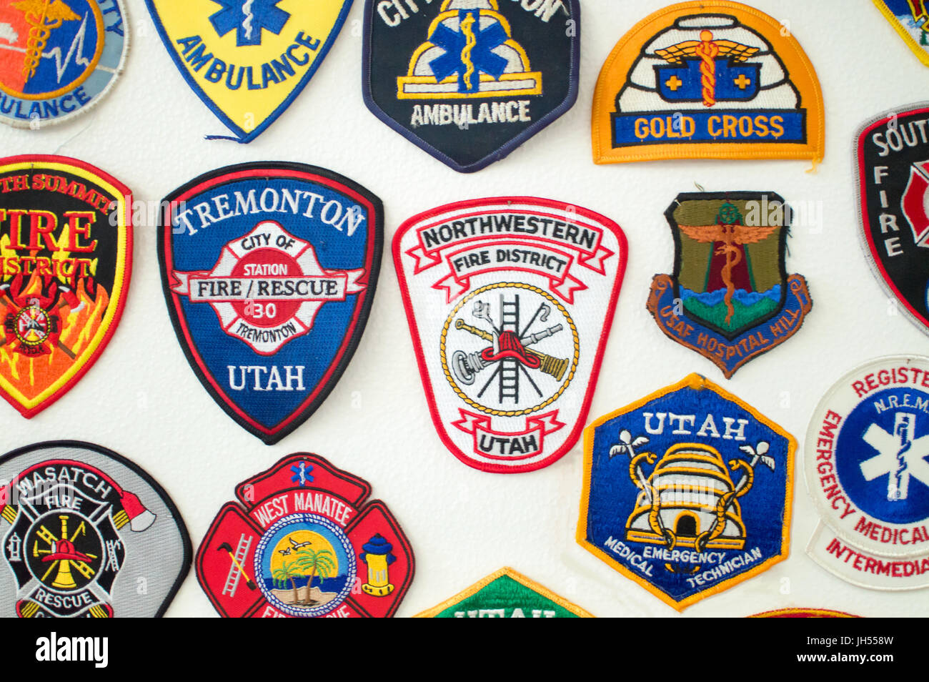 Emergency services patches on display. Main area is Utah - Stock Image