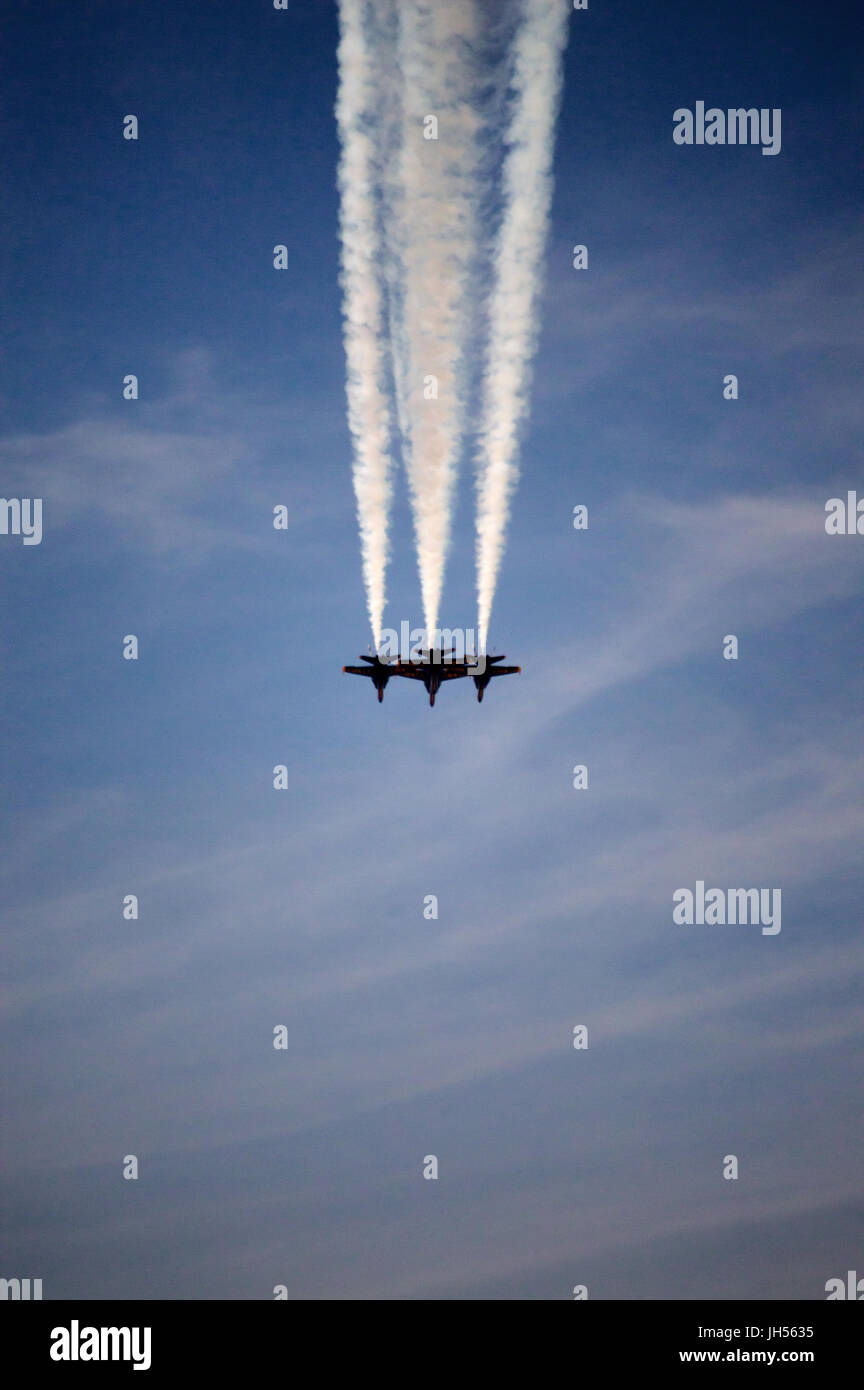 Three blue angel jets flying over their home base in Florida. - Stock Image