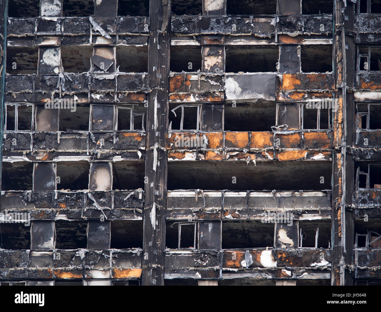 London, UK - Jul 4, 2017: Close up view of the Grenfell Tower block of council flats in which at least 80 people - Stock Image