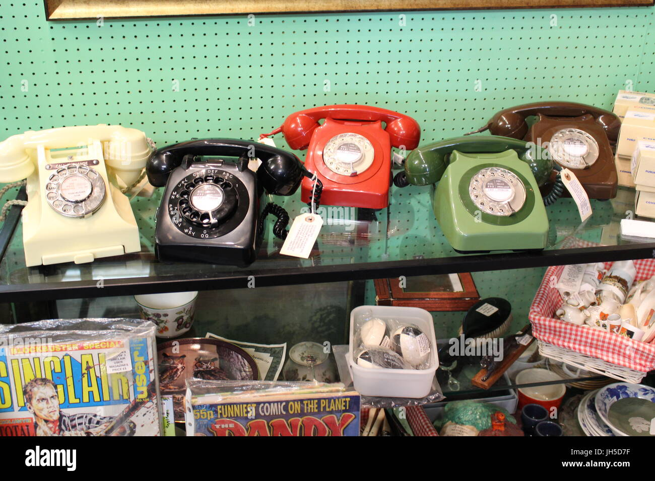 old phones, antique phones, phones on display, telephones, old fashioned phones, trendy interiors, trends, kitsch, - Stock Image
