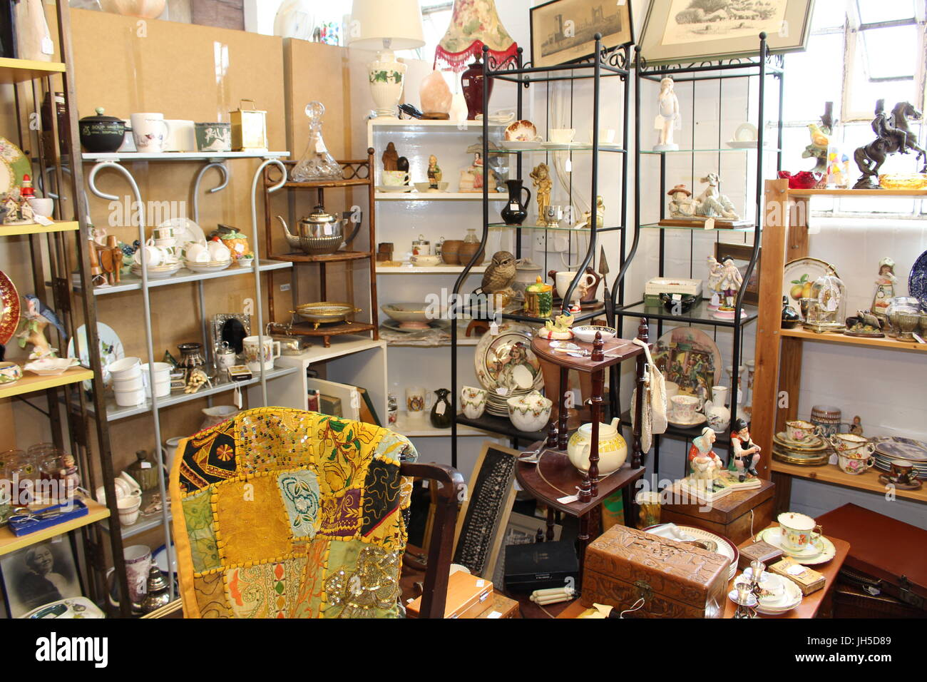display in a charity shop, thrift shop, thrift shopping, antiques, bargain hunting, antique store, second hand store, - Stock Image