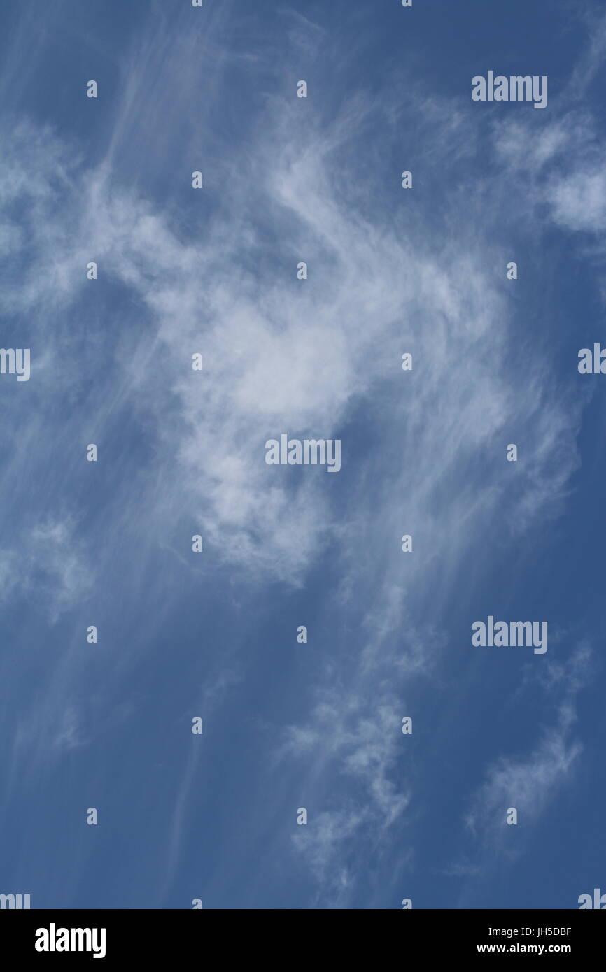 blue sky with wispy clouds, clouds, sky - Stock Image