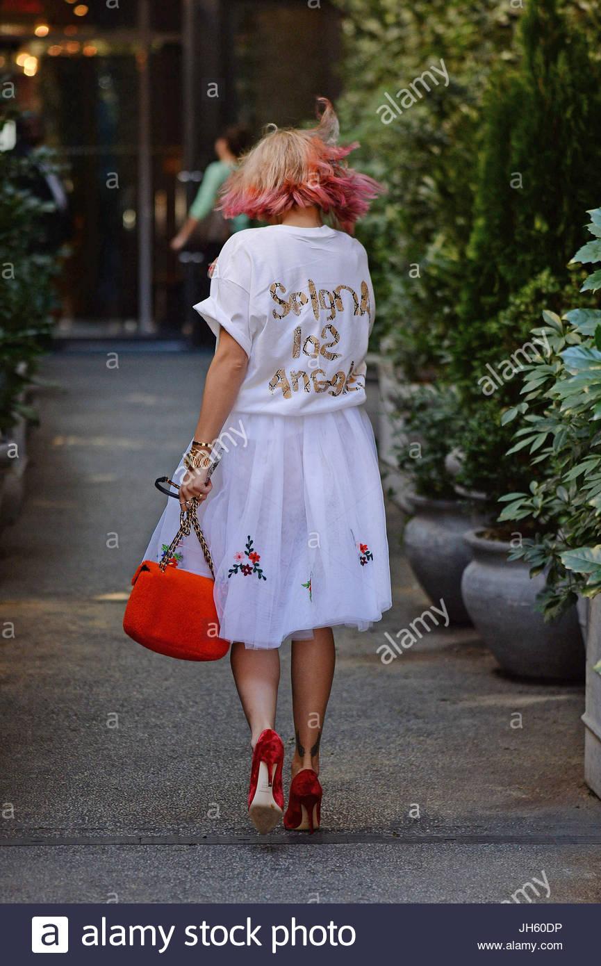 Rita Ora. Rita Ora looks stylish in pretty white skirt, which Stock ...