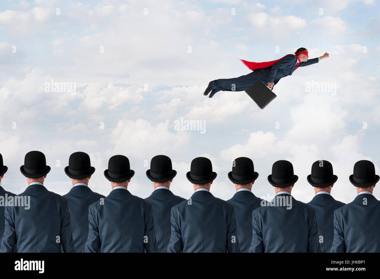 business progress concept superhero businessman flying past static competition - Stock Image