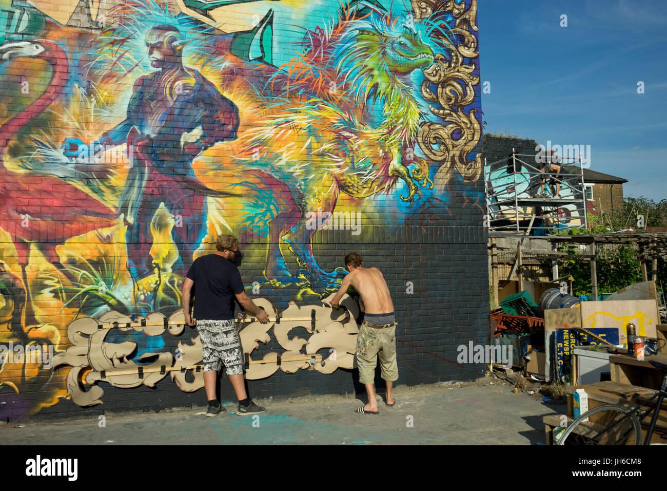 4ddbe8e3eba Graffiti artists at the Nomadic communal gardens space in Shoreditch ...