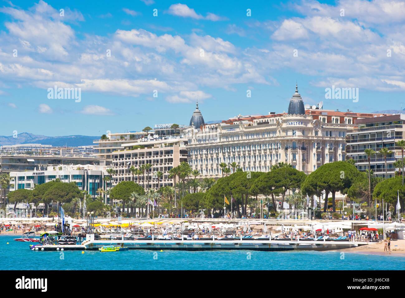 Promenade de la Croisette, Cannes, France with the famous hotel Carlton and Martinez - Stock Image