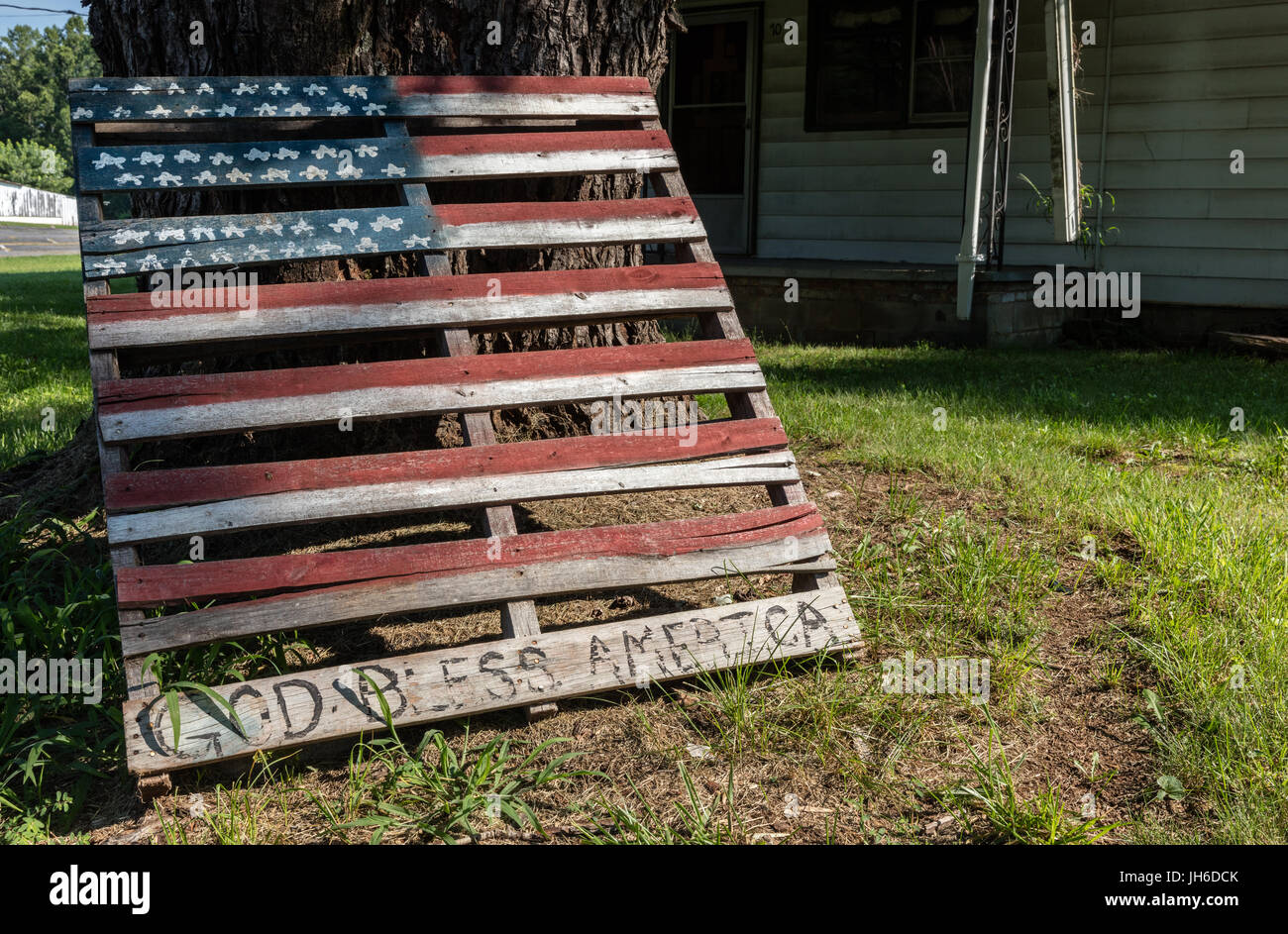 Morganton, NC - 12 July 2017: Hand painted American Flag on Lawn in the Heart of the Bible Belt - Stock Image