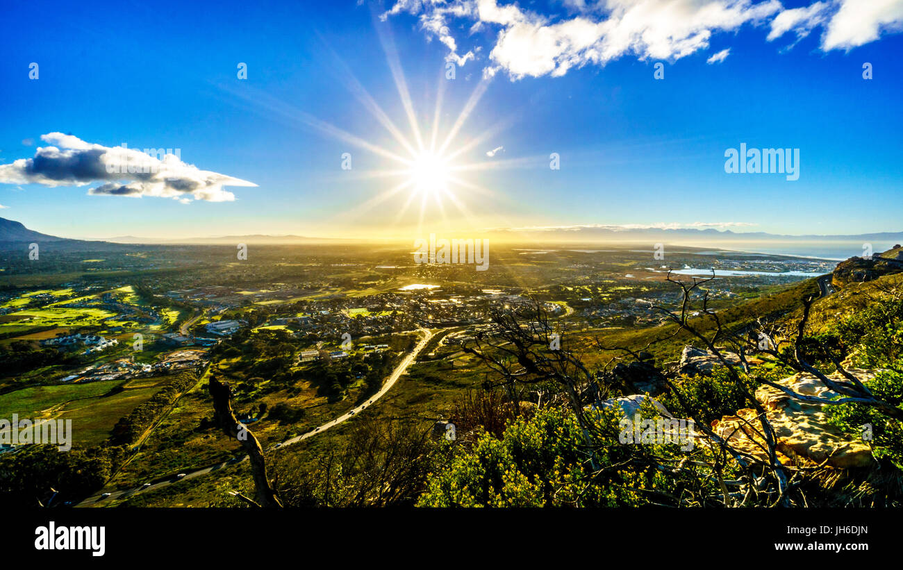 Gorgeous Sunrise over the beautiful scenery of the Western Cape from the Ou Kaapse Weg, Old Cape Road, on a clear - Stock Image