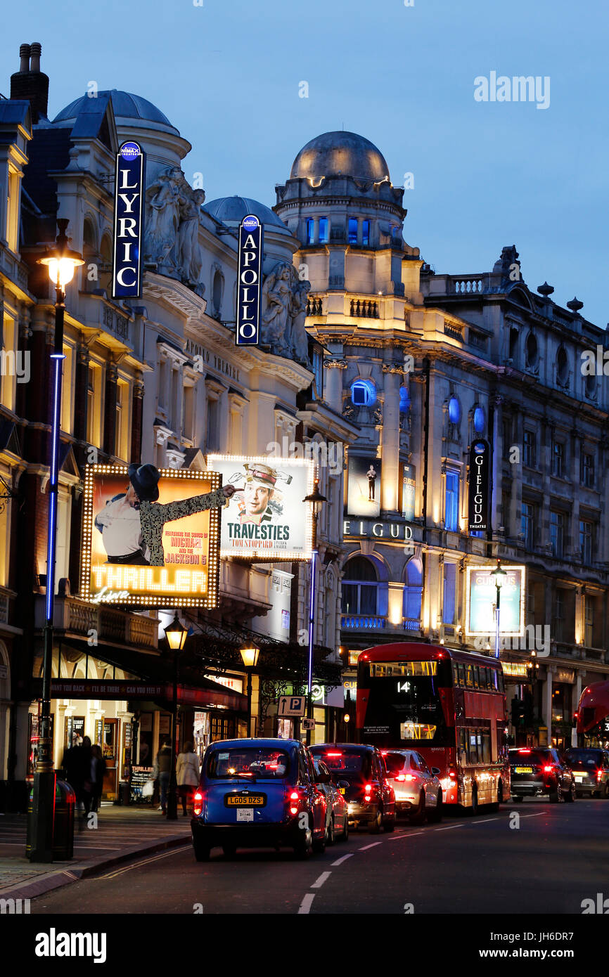 London cityscape around Shaftesbury Avenue, most famous for a theatre land,  at night. Many theatres and traffics - Stock Image