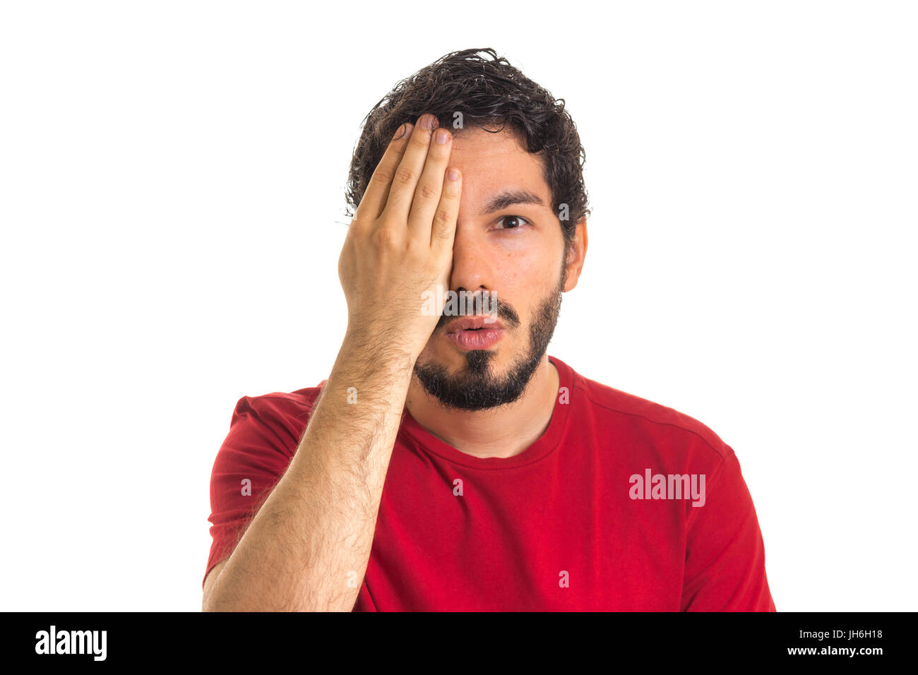 The hand covers one eye of handsome man. eye examination ophthalmology concept in white background. - Stock Image