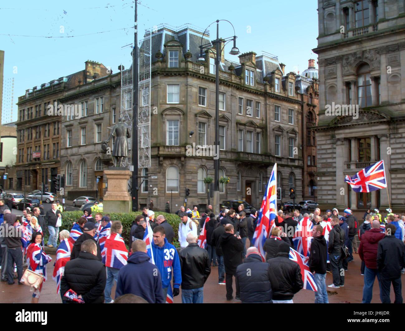 protestant loyalist unionist Rangers football club rally George Square Glasgow Scotland union jack flags - Stock Image