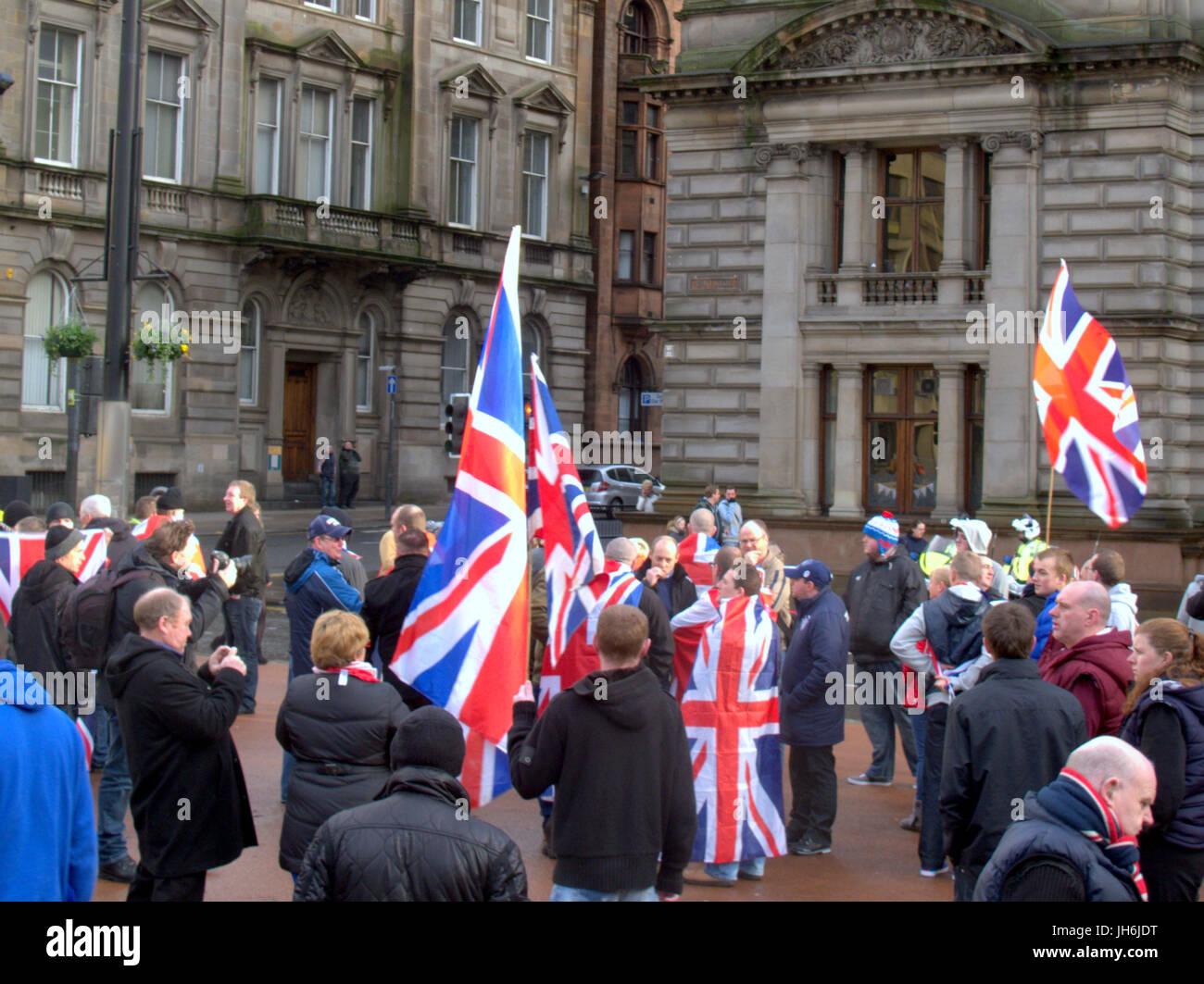 protestant loyalist unionist Rangers football club rally George Square Glasgow Scotland union jack flags keeks - Stock Image