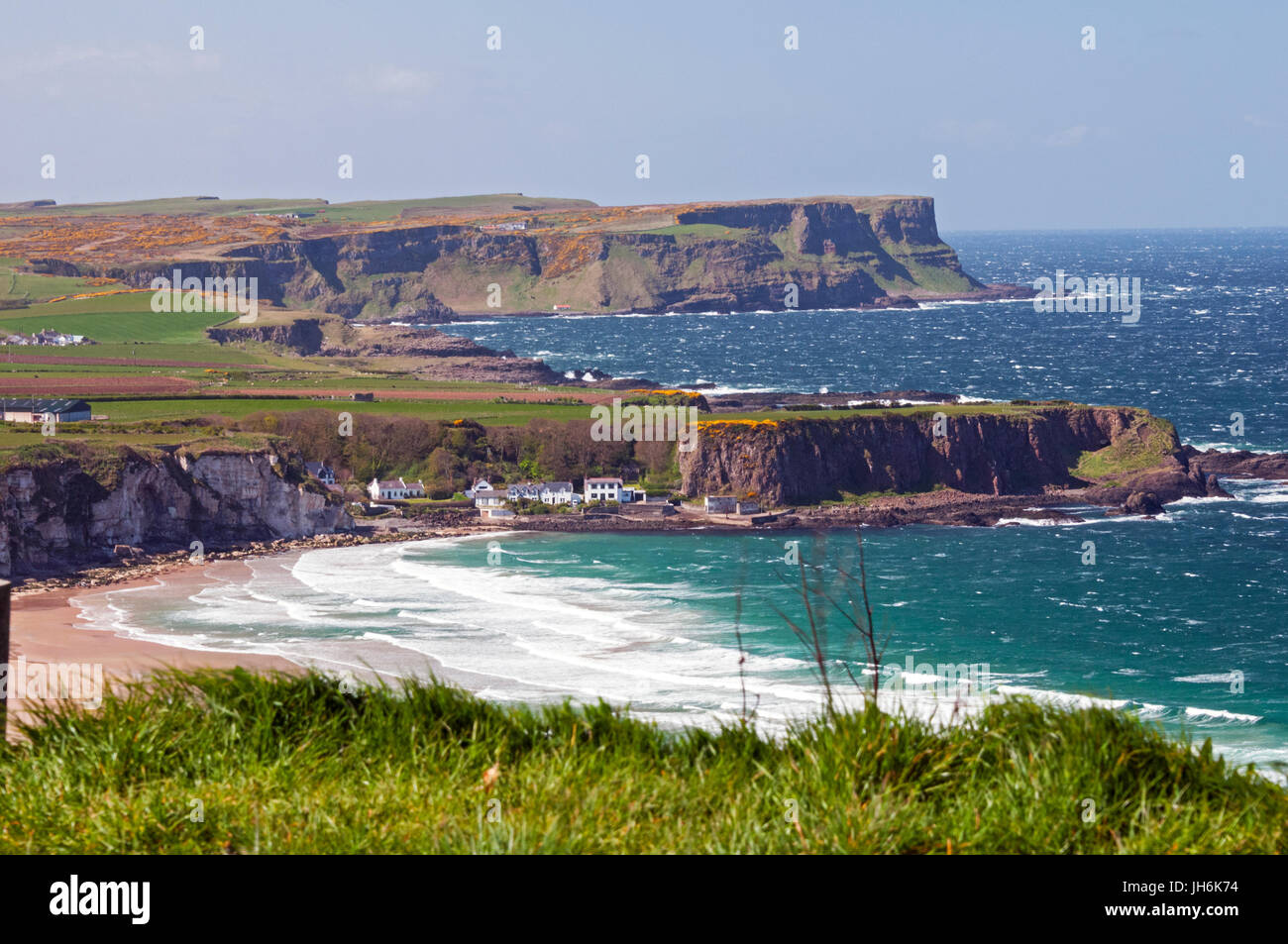 Whitepark Bay and beach and cliffs of Causeway Coast to the west, Northern Ireland - Stock Image