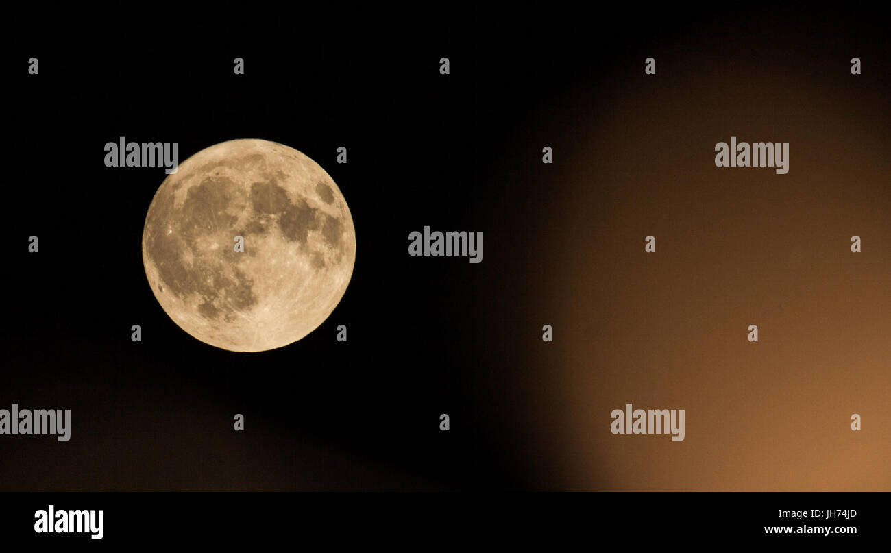 full moon with caption space to the right - Stock Image