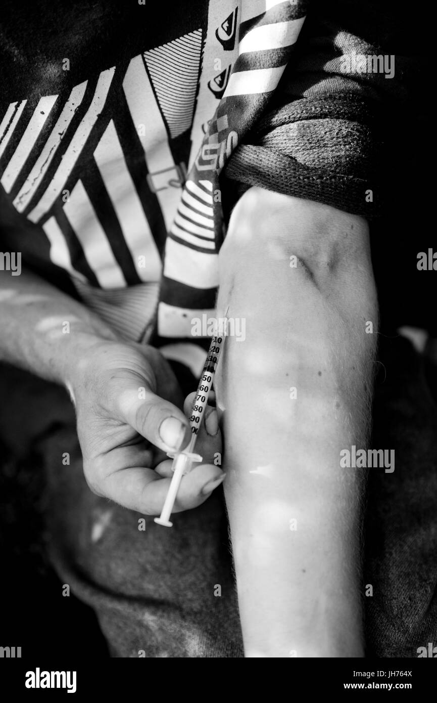 A longtime 'maintainance' drug addict, 'Joe' fixes with about $3.00 worth of prepared heroin. - Stock Image