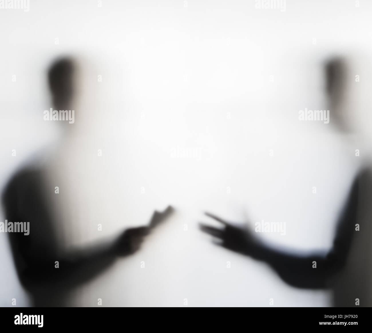 Two men making dubious negotiation behind a curtain concept - Stock Image