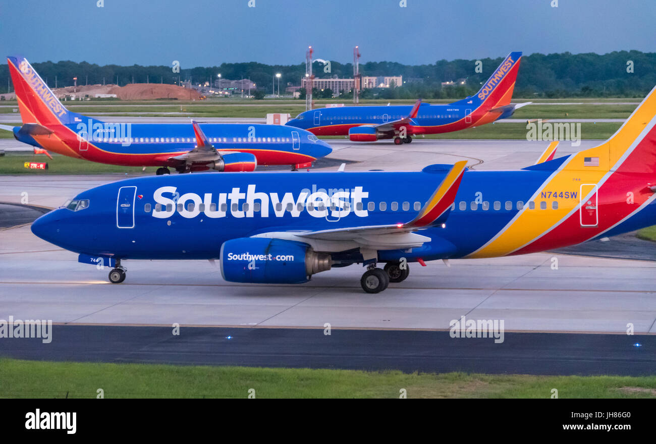 Southwest Airlines jets (Boeing 737s) on a crowded airfield at Hartsfield-Jackson Atlanta International Airport, - Stock Image