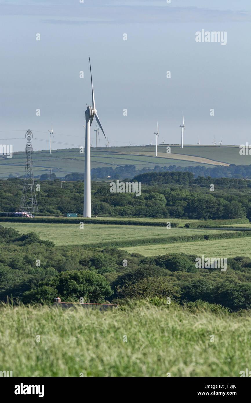 Large wind turbine / wind generator set against hazy blue summer sky near the village of St. Dennis in Cornwall, - Stock Image