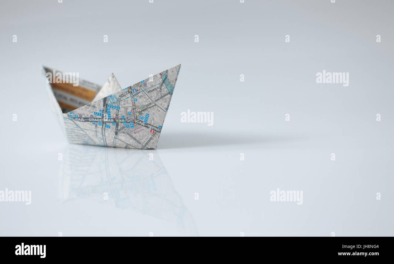 Paper ships from the map on a white - Stock Image