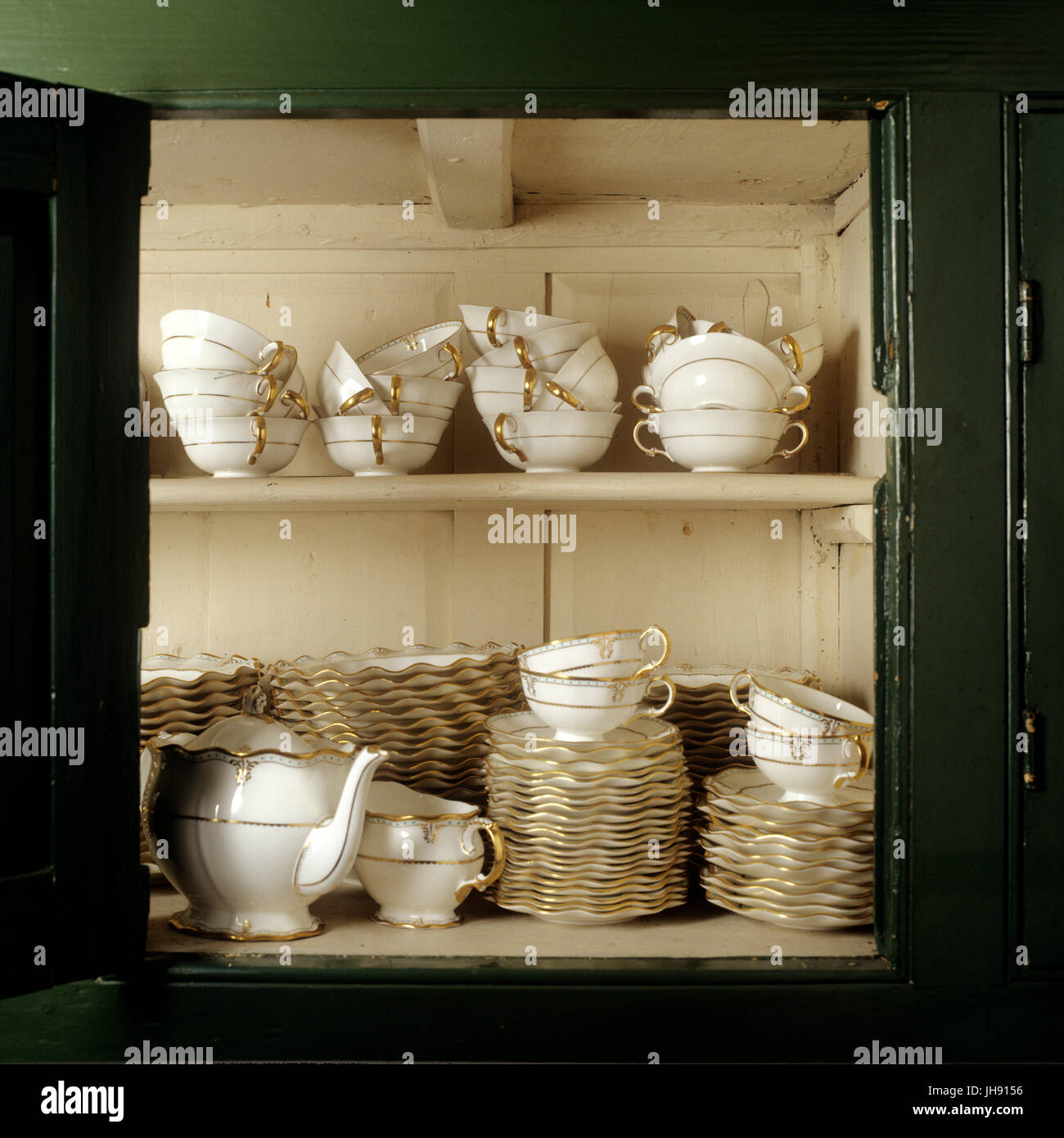 Messy Cups Plates: Cluttered Messy Shelves Stock Photos & Cluttered Messy