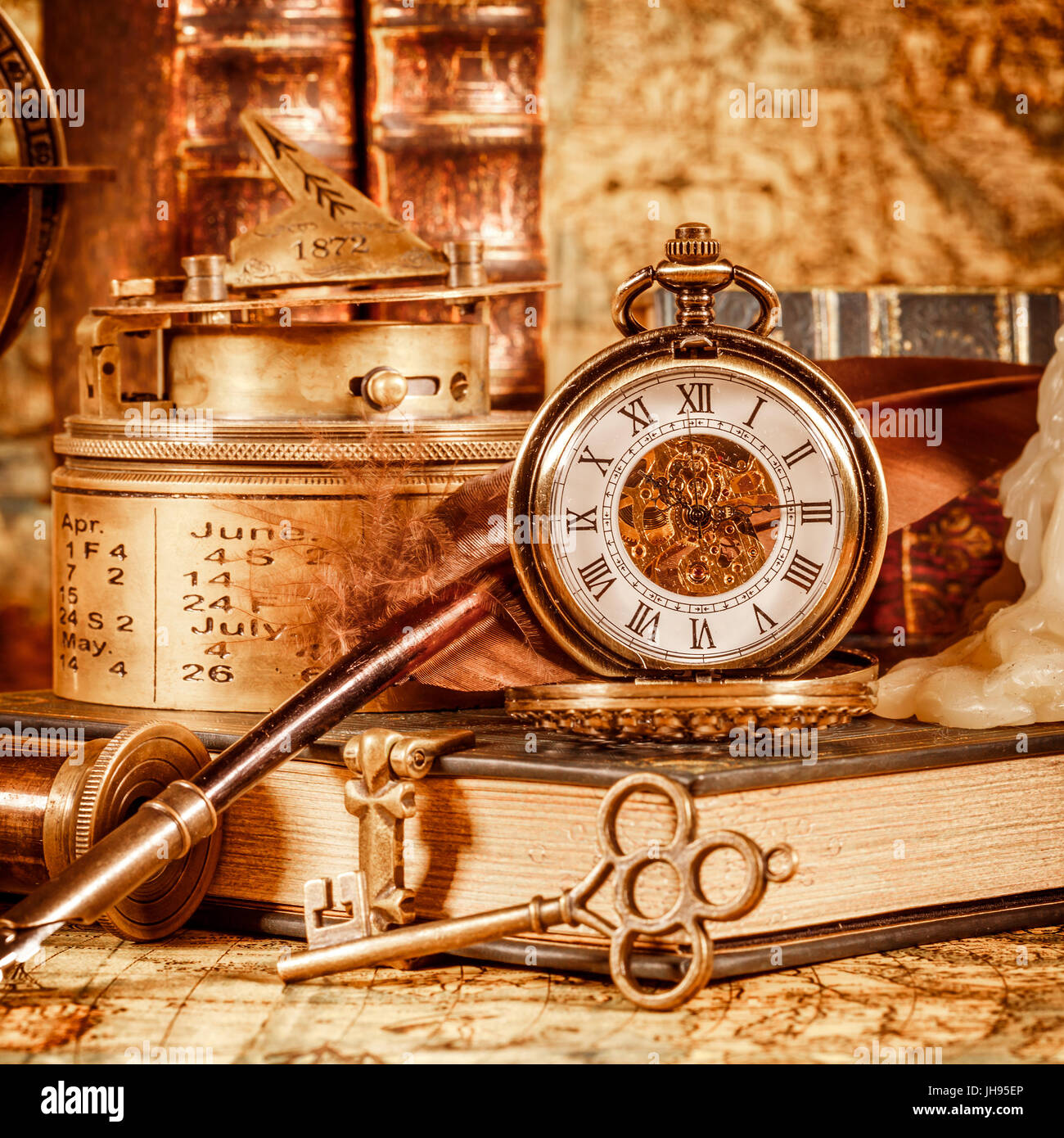 Vintage book compass telescope and a pocket watch lying on ancient vintage book compass telescope and a pocket watch lying on ancient world map in 1565 gumiabroncs Image collections