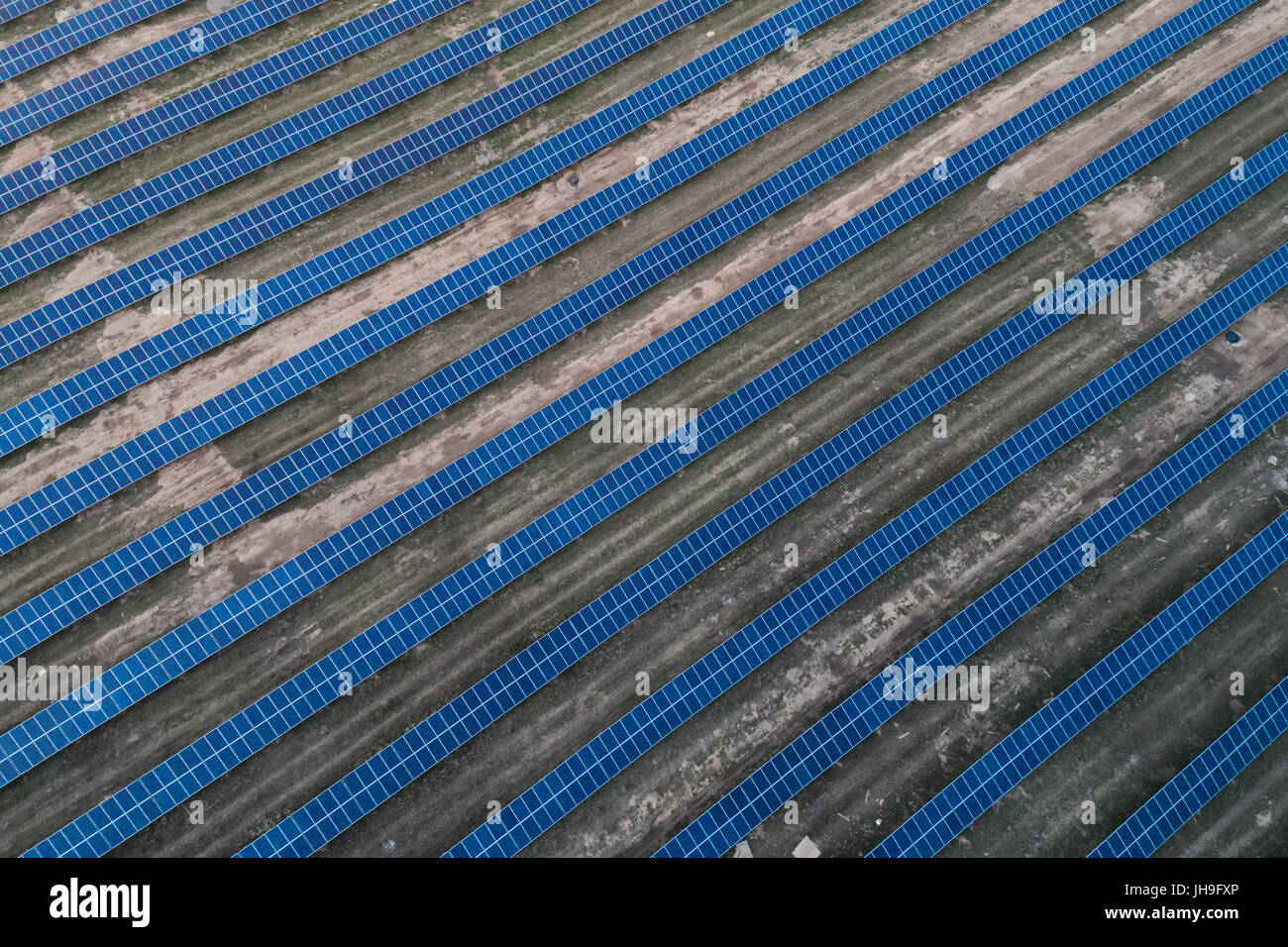 Solar panels placed on a countryside meadow. - Stock Image
