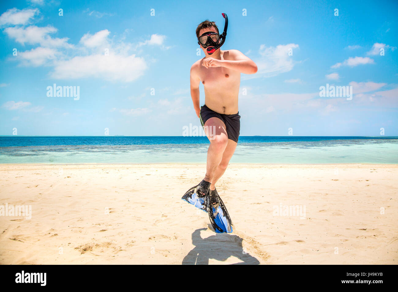Funny Man Jumping In Flippers And Mask Holiday Vacation On A Tropical Beach At Maldives Islands Stock Photo Alamy