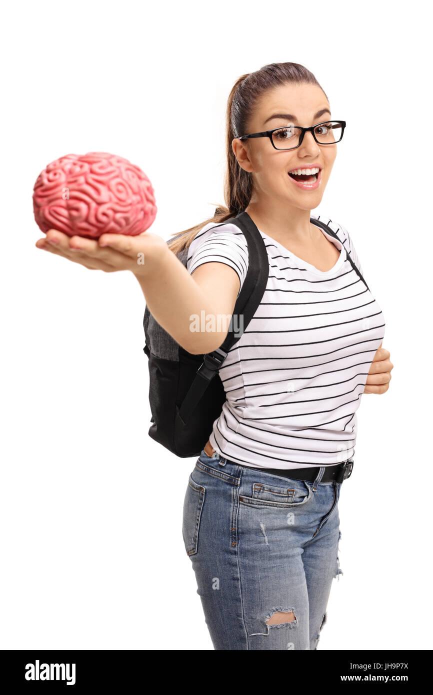 Teenage student holding a brain model isolated on white background - Stock Image