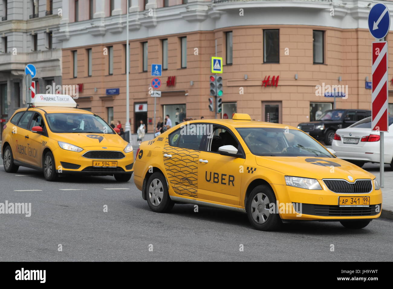 Moscow, Russia  13th July, 2017  Yandex Taxi and Uber taxicabs in a