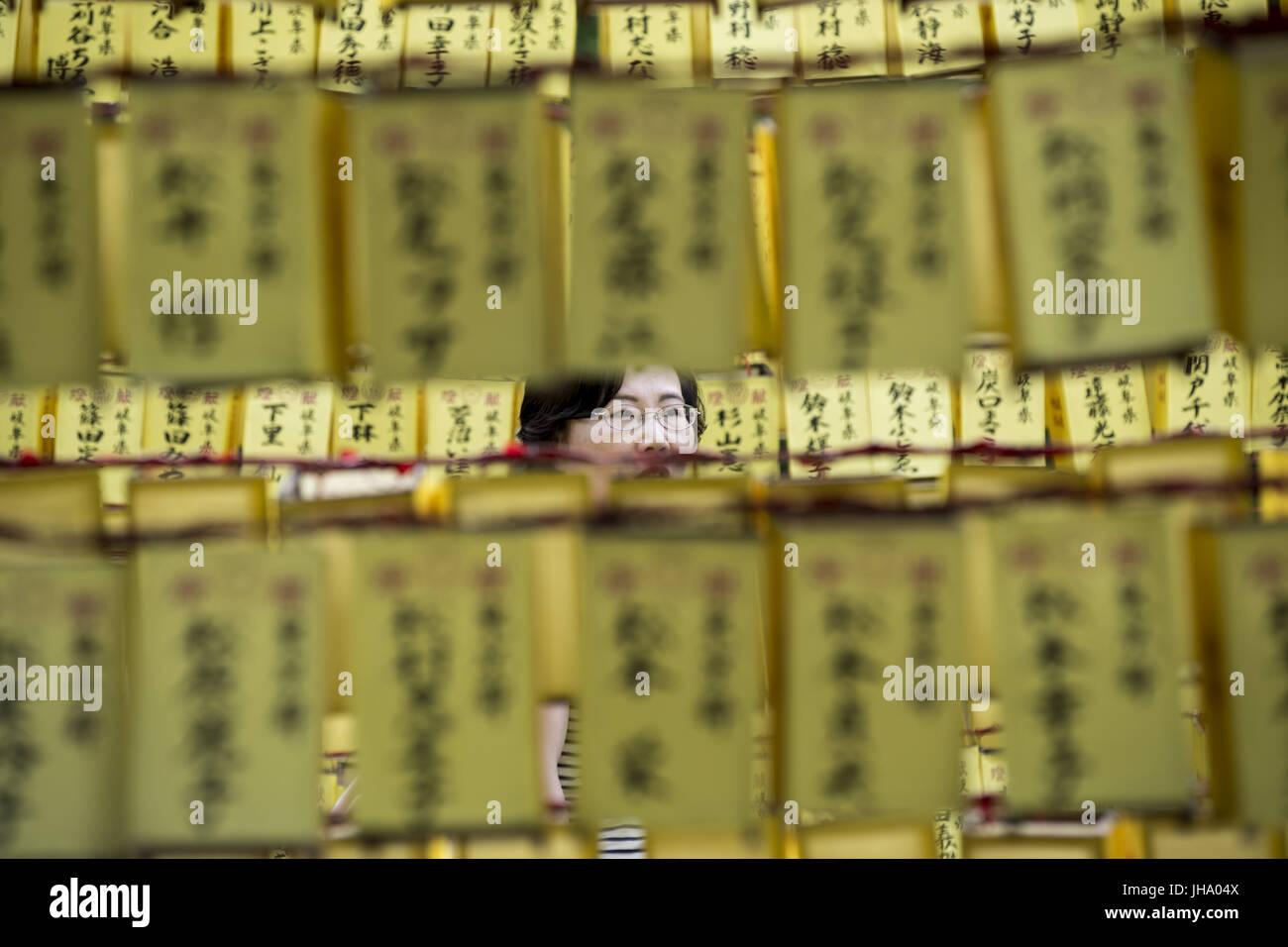 Hiratsuka, Kanagawa, Japan. 13th July, 2017. Visitor enjoy the display of a row of paper lanterns with the names - Stock Image