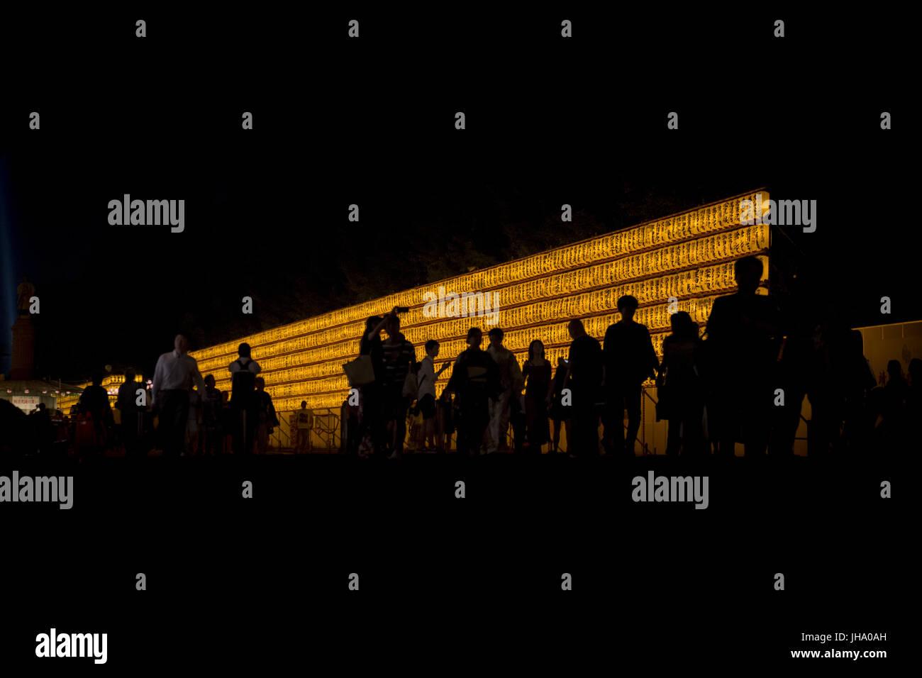 Hiratsuka, Kanagawa, Japan. 13th July, 2017. Visitors walk between rows of lit lanterns during the festival of ''Mitama'' - Stock Image