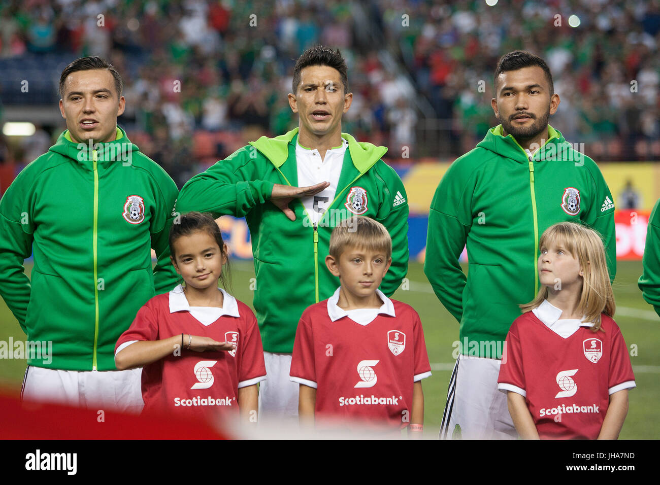 Denver, Colorado, USA. 13th July, 2017. Mexico MF JESUS MOLINA, top center, sings the Mexican National Anthem with - Stock Image