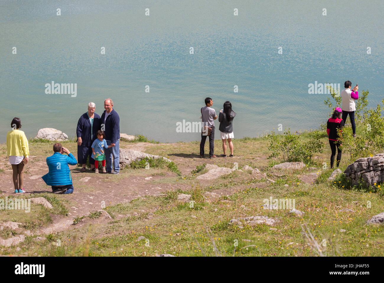 Tourists are taking photos at Medicine Lake in Jasper National Park, Alberta, Canada Stock Photo