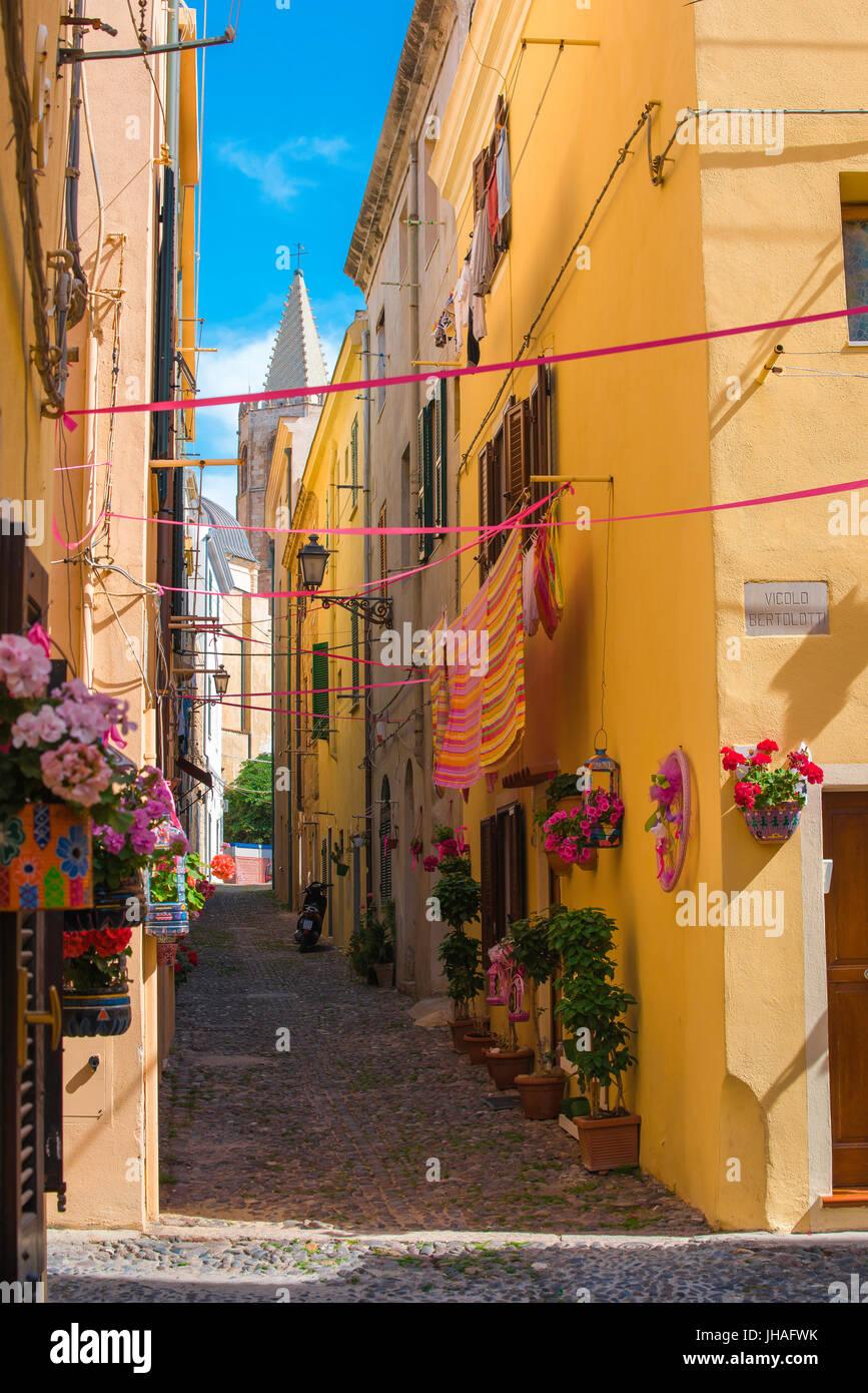Sardinia coast, a colourful street in the historic old town quarter of Alghero, northern Sardinia. - Stock Image