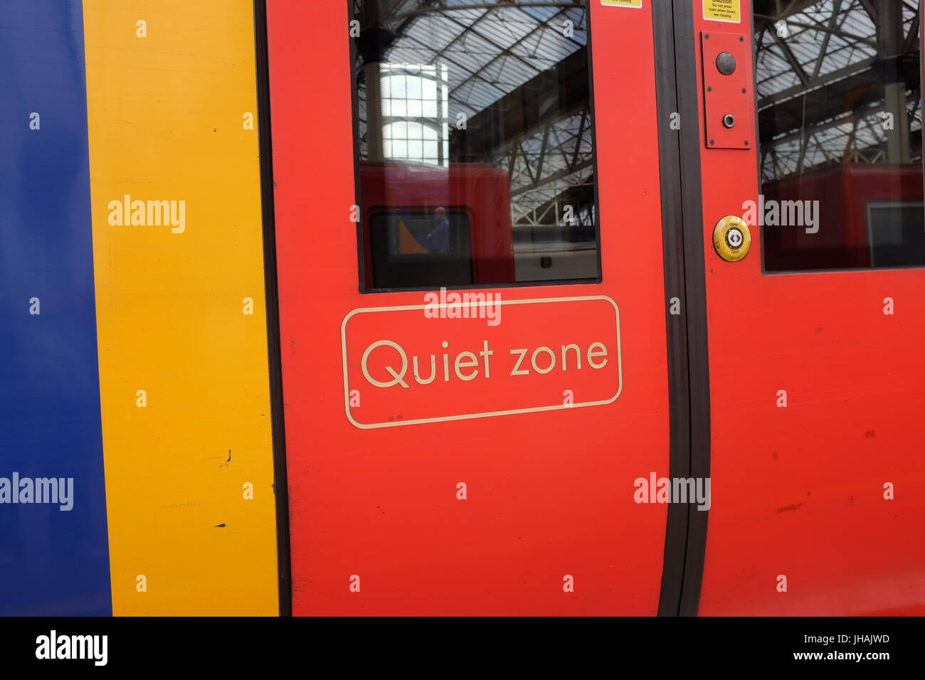 'Quiet zone' on the doors of a South West Trains carriage. - Stock Image