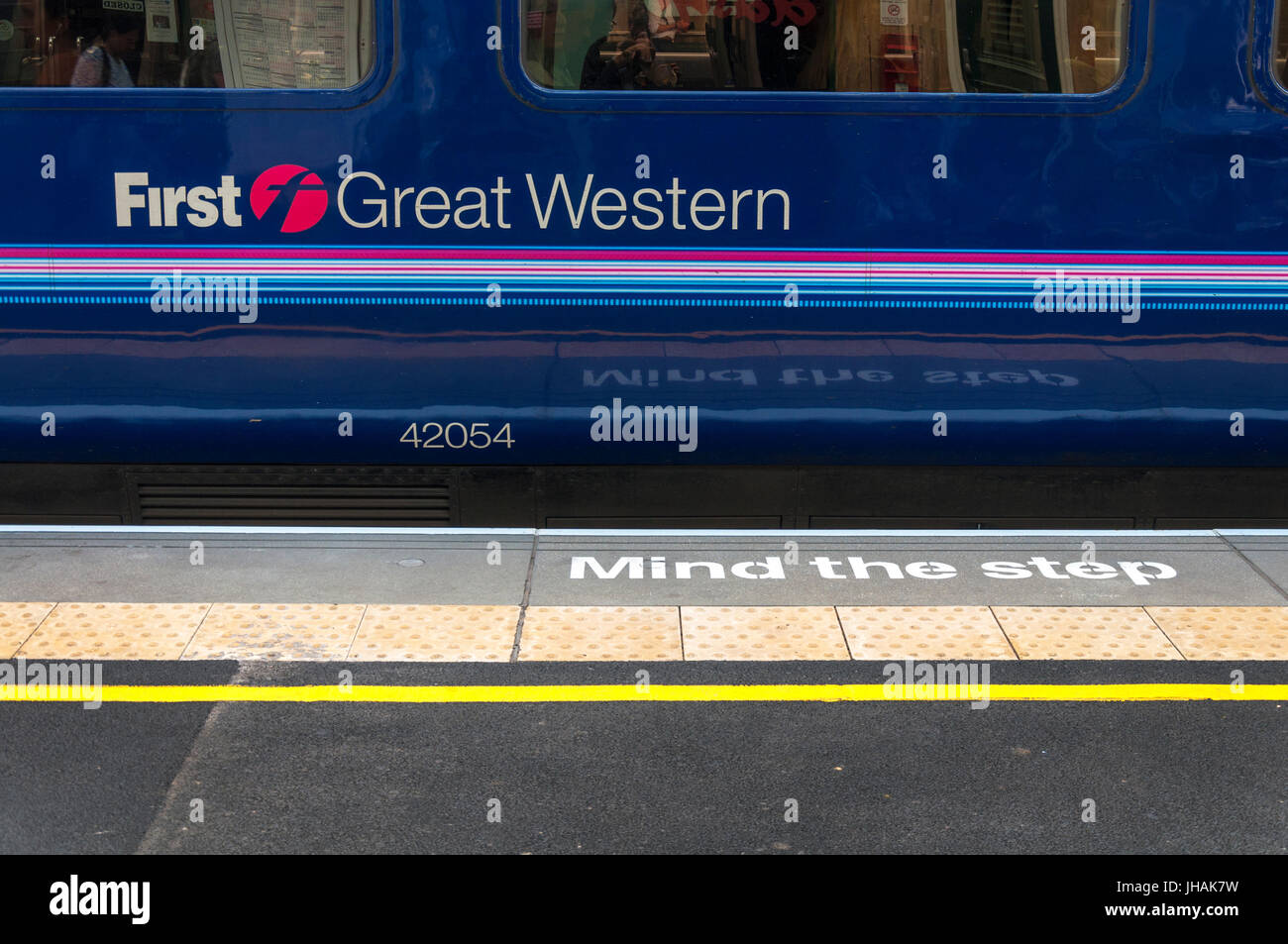 Mind the Step safety warning and a First Great Western train at Bath Spa railway station, Somerset, England, UK Stock Photo
