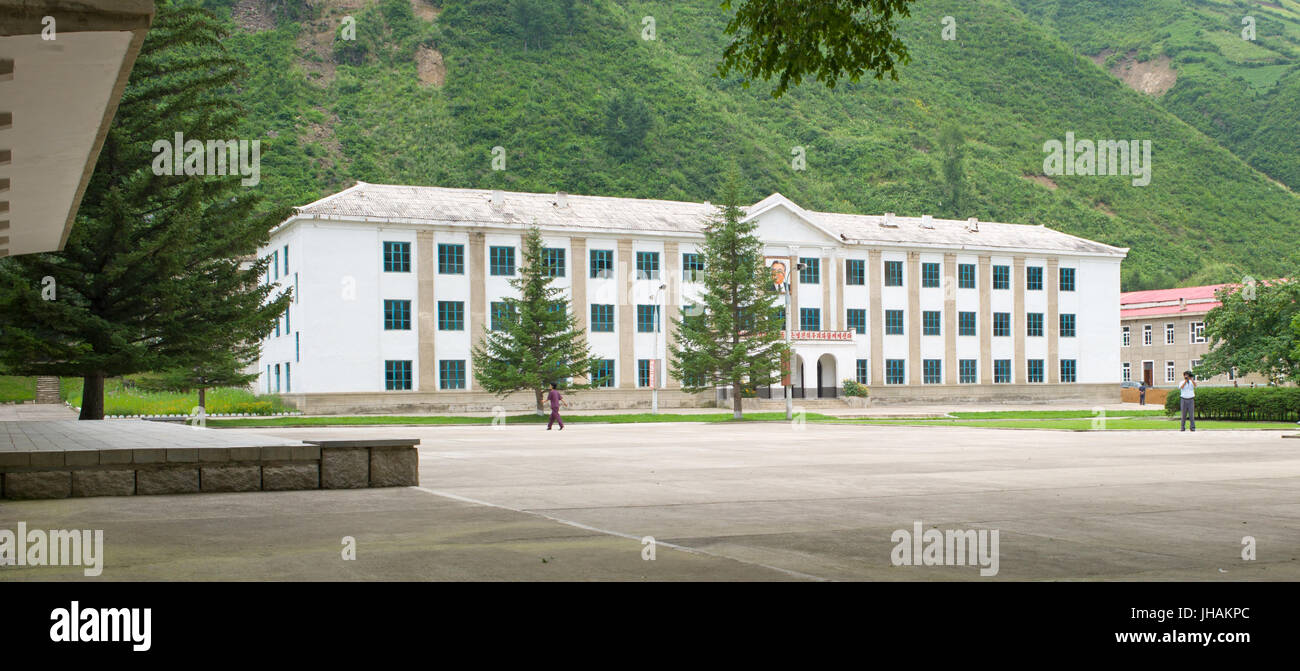 Public building in Pochonbo, with portrait of Kim Il-Sung hanging over entrance. DPRK / North Korea - Stock Image