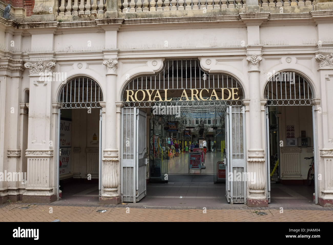The entrance to the Royal Arcade shopping arcade in Boscombe, near Bournemouth, Dorset, England. - Stock Image