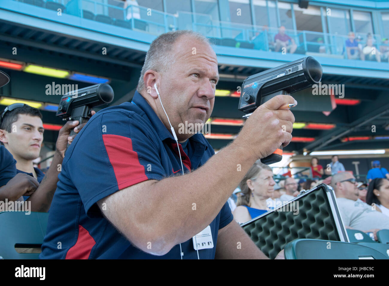 Boston Red Sox Scouting Supervisor Ray Fagnant monitoring pitchers on a radar gun at a Brooklyn Cyclones minor league - Stock Image