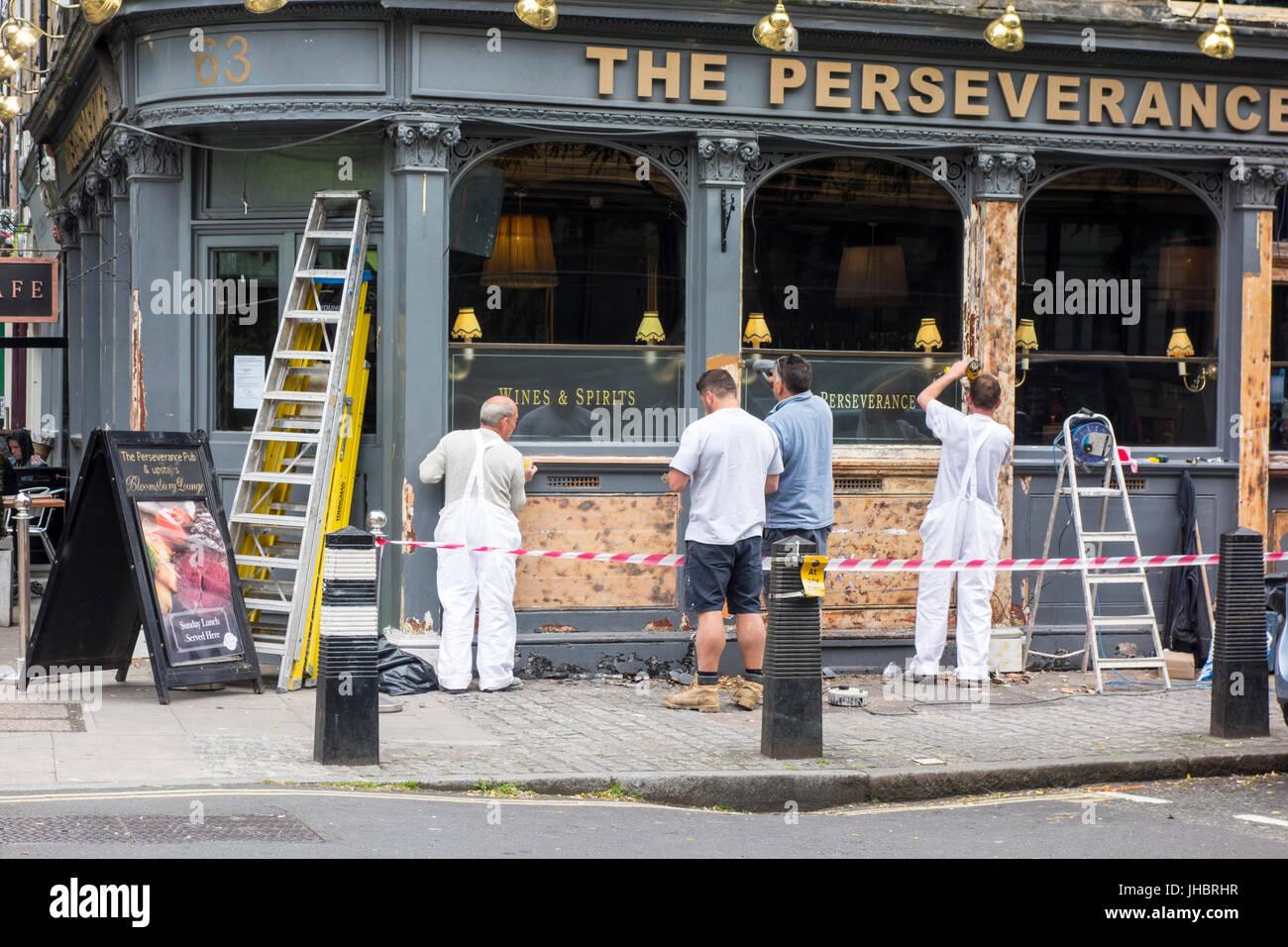 Workmen renovating the Perseverance pub bar London, UK - Stock Image