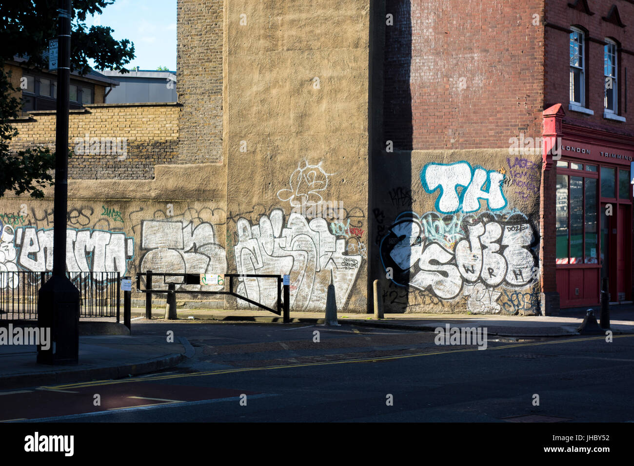Graffiti on the side of a building, Cambridge Heath Road, Bethnal Green, Tower Hamlets, East London, UK - Stock Image