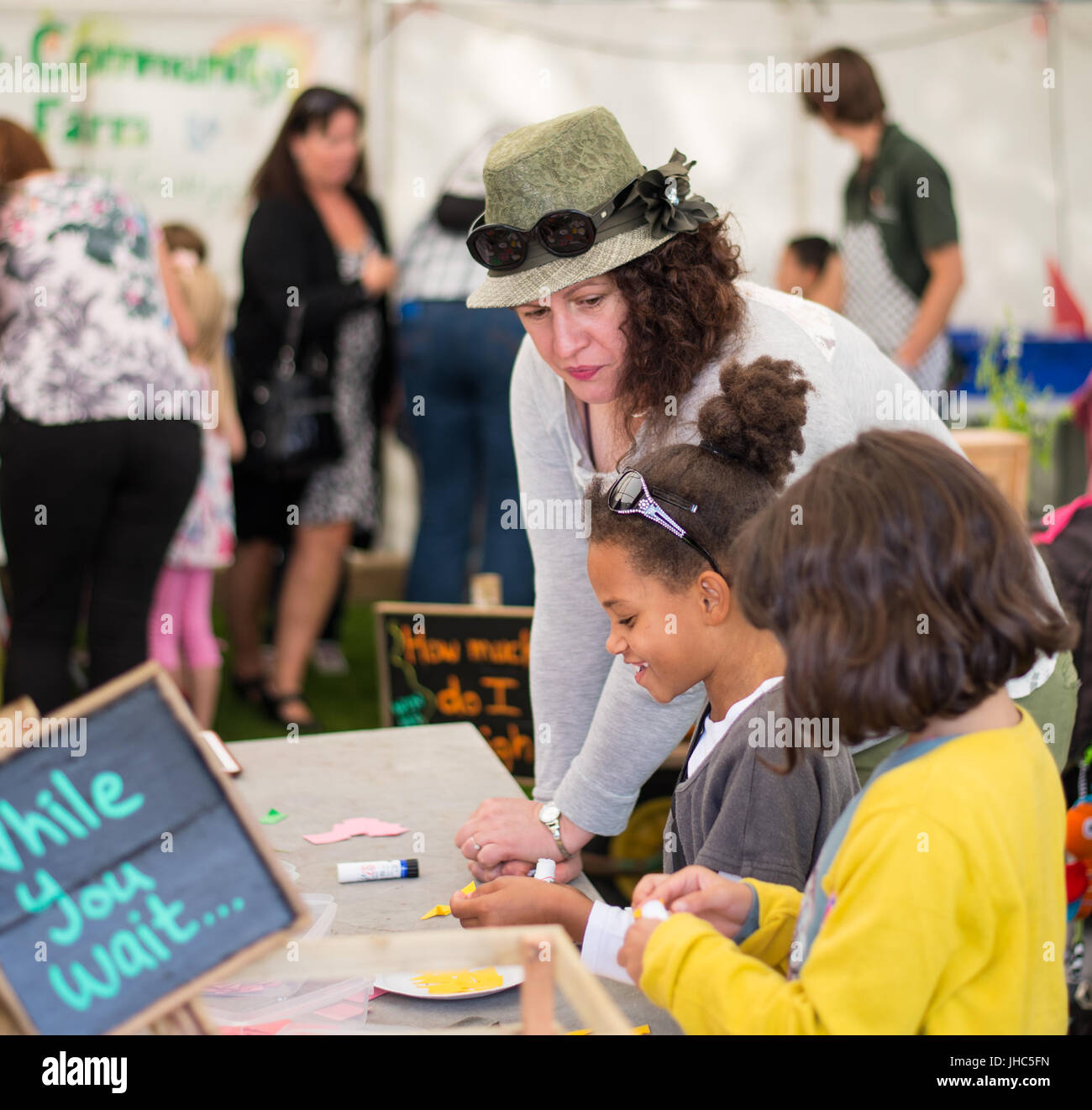 Children doing crafts at Isle Of Man Food & Drink Festival - Stock Image