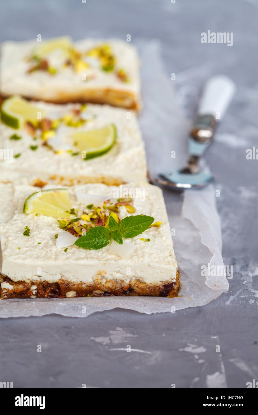 Raw pistachio, coconut and lime cheesecakes. Love for a healthy vegan food concept. - Stock Image