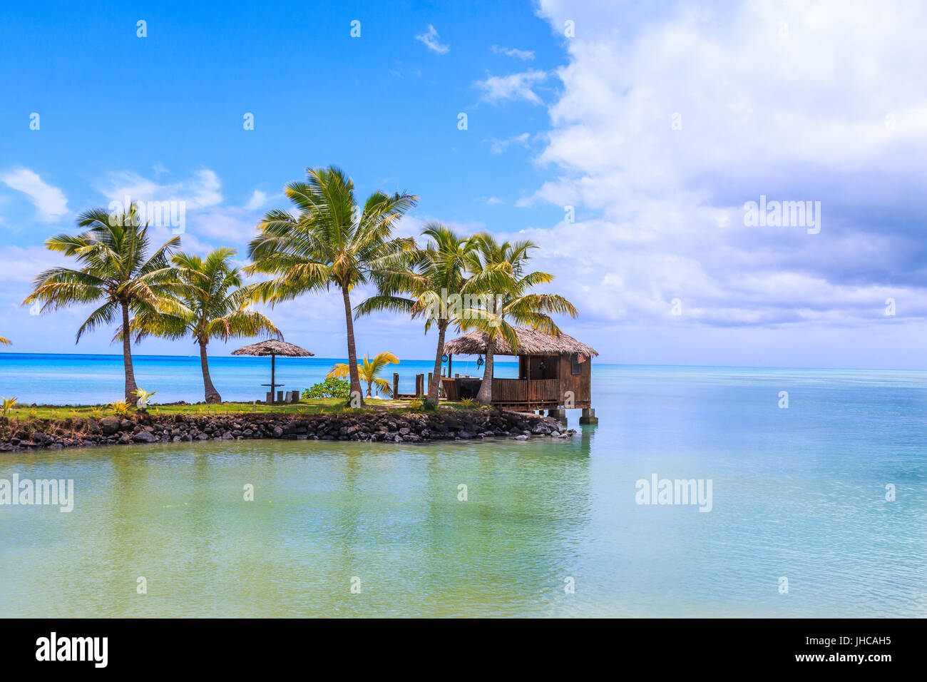 Samoa Island.Tropical beach on Samoa Island with palm trees. - Stock Image