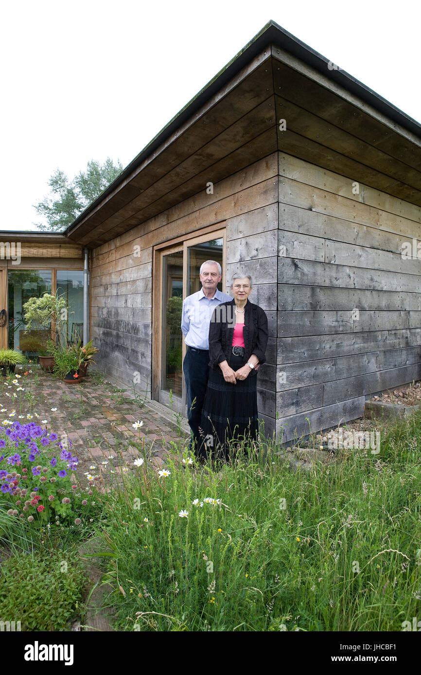 Picture shows Bill and Rosie Marshall in 2011 at their home Cobtun, Worcester a cob eco cabin built in 2001 by Birmingham's - Stock Image