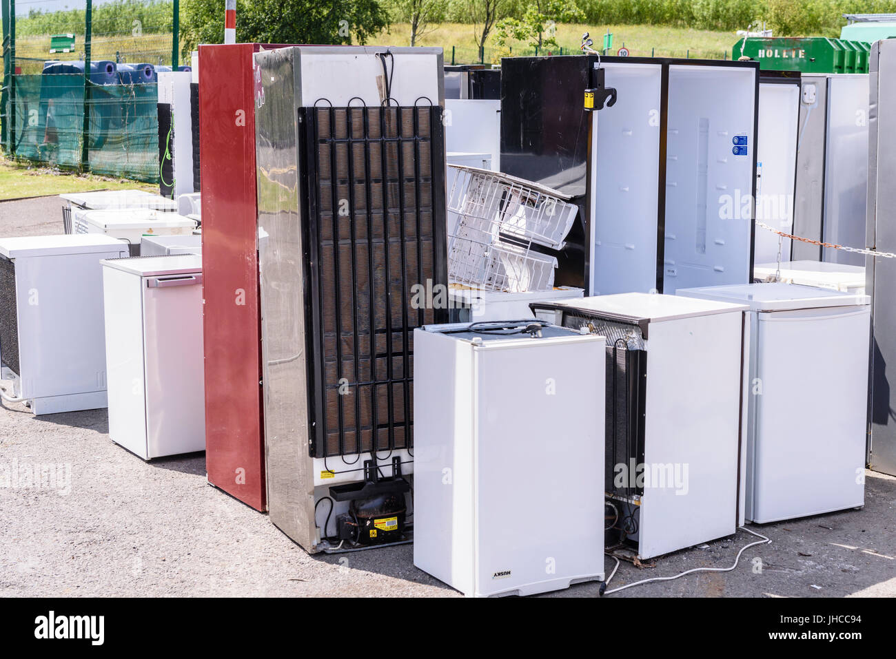Broken refrigerators at a recycling centre, waiting to be disposed of and recycled in an environmentally friendly - Stock Image