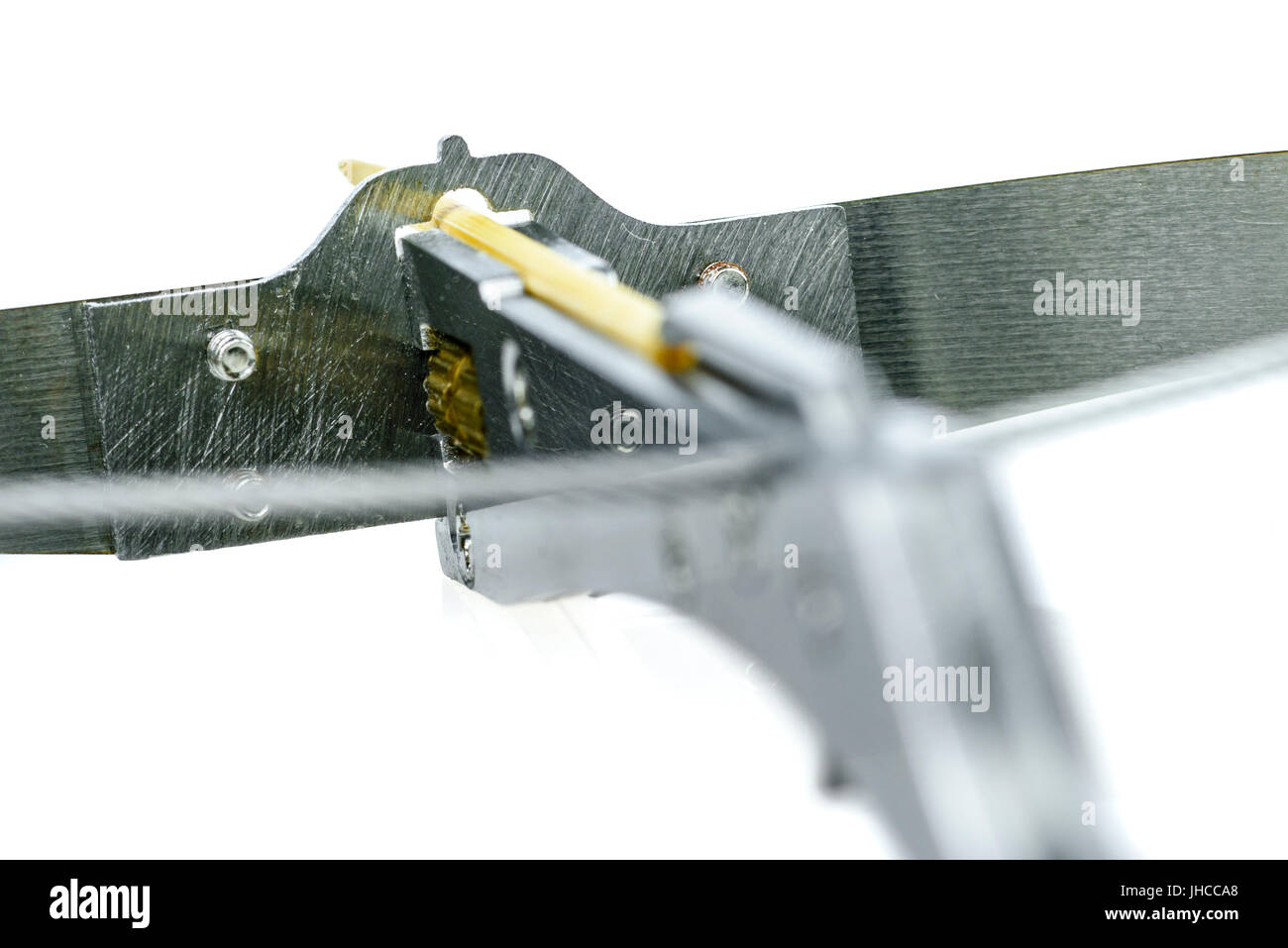 Toothpick catapult, a dangerous steel 'toy' from China which fires toothpicks with enough force to break - Stock Image