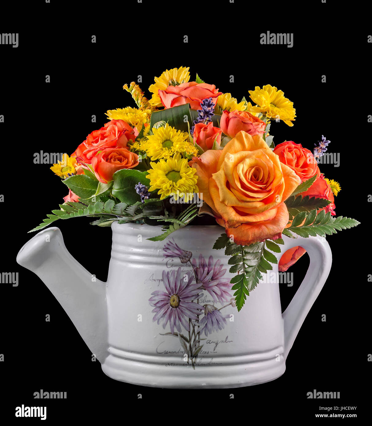 Vivid Colored Flowers Orange Roses In A White Sprinkler Watering